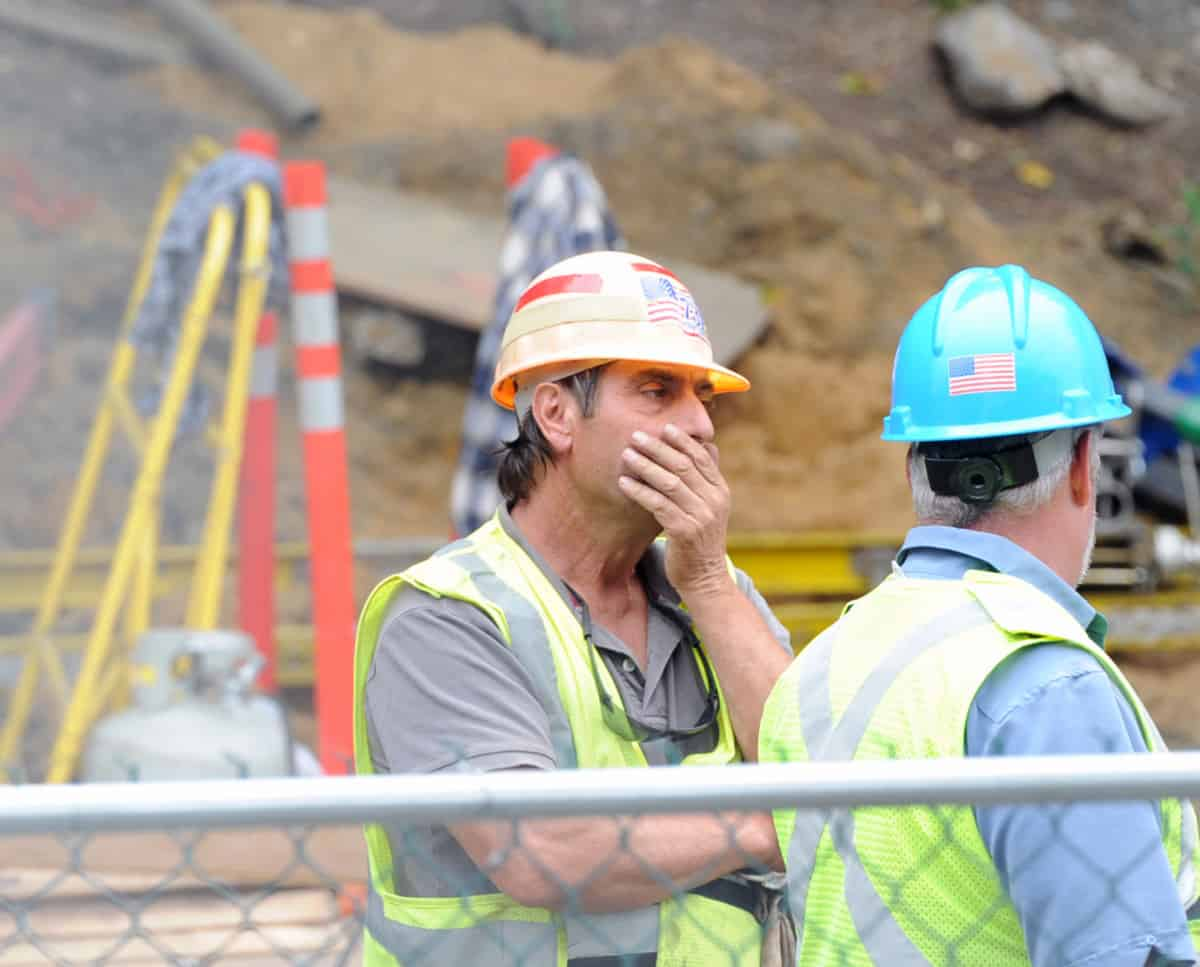 Construction Worker Noticing Red Flags in their Construction Software