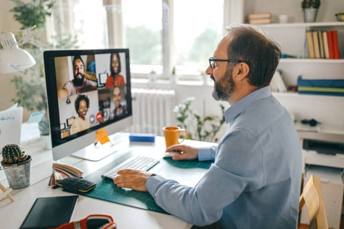 construction office employees holding a virtual meeting while working remotely