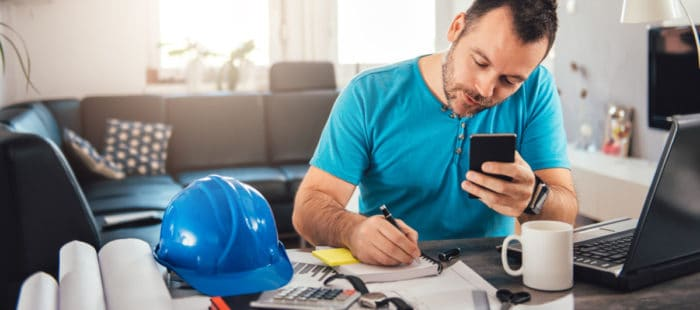 Construction company employee getting work done at home