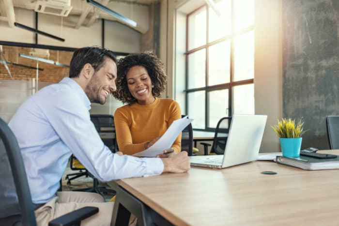 employees looking at productivity analytics after implementing new ERP software