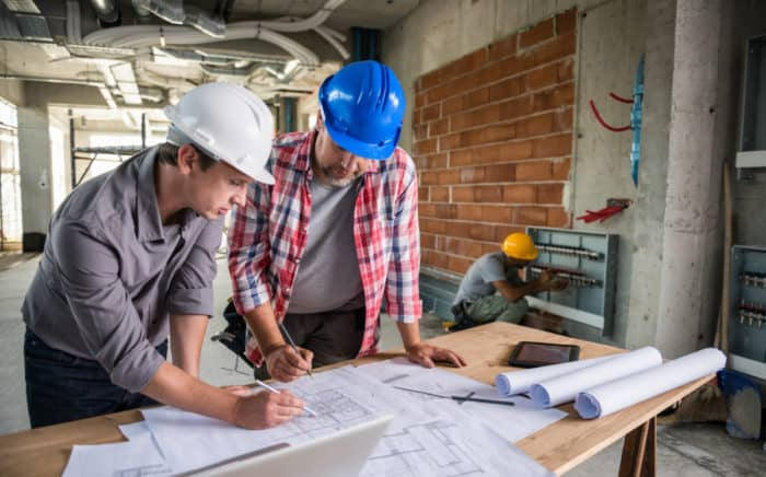 Two subcontractors identifying their separate tasks in a project