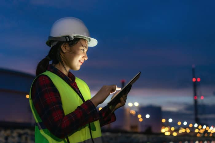 Commercial construction contractor filling out digital construction billing forms