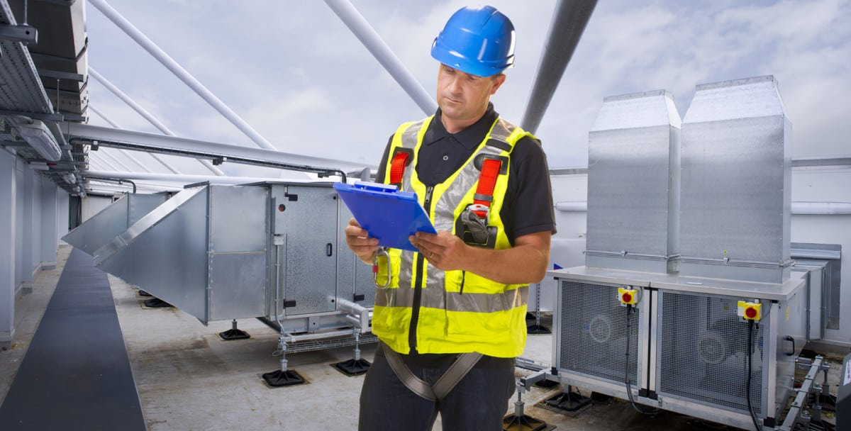 Contractor using software to solve productivity issues in construction while installing HVAC units