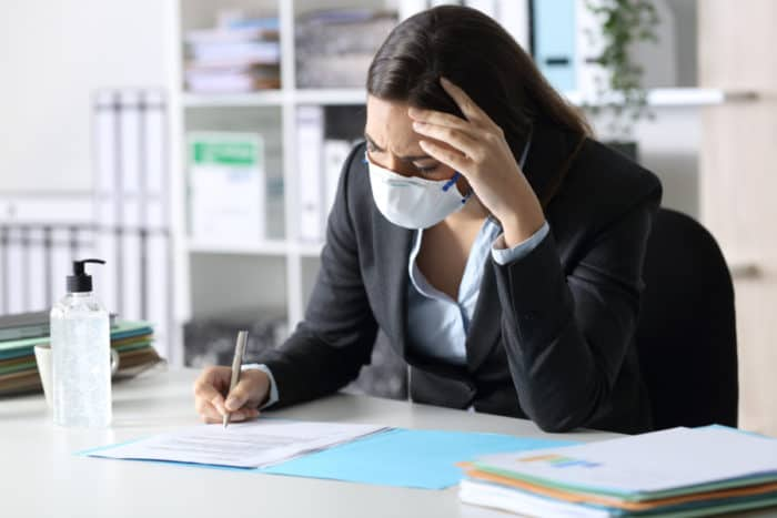 frustrated-woman-filling-out-AIA-G702/G703-documents